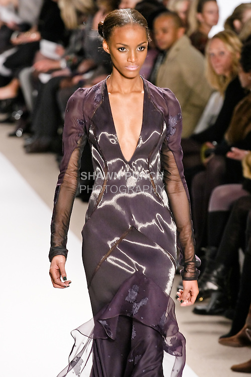 Sedene Blake walks the runway in an Aubergine liquid wool and chiffon gown, by Dennis Basso for his Dennis Basso Fall Winter 2010 collection fashion show, during Mercedes-Benz Fashion Week Fall 2010.