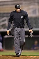 Home plate umpire David Martinez between innings of the South Atlantic League game between the Hagerstown Suns and the Kannapolis Intimidators at Kannapolis Intimidators Stadium on May 4, 2016 in Kannapolis, North Carolina.  The Intimidators defeated the Suns 7-4.  (Brian Westerholt/Four Seam Images)