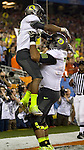 01/11/11--Oregon running back LaMichael James is lifted up after scoring a touchdown in the first half of the BCS National Championship..Photo by Jaime Valdez.....