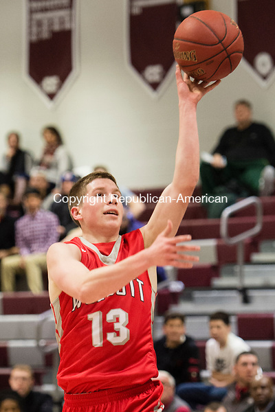 NAUGATUCK, CT - 29 December 2015-122915EC06--   Wolcott's Jack Rocco gets two points against Naugatuck Tuesday night. Erin Covey Republican-American.