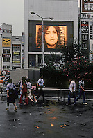 Tokyo: Giant TV screen, Shinjuku Station. (American Rock Musician in interview) Photo '81.