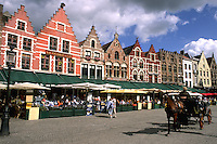 Belgium Great cafes and horse carriage with tourists in Marketplace in beautiful downtown Bruges Belgium