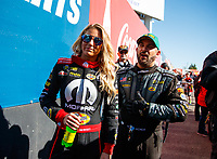 Feb 25, 2018; Chandler, AZ, USA; NHRA top fuel driver Leah Pritchett (left) with Tony Schumacher during the Arizona Nationals at Wild Horse Pass Motorsports Park. Mandatory Credit: Mark J. Rebilas-USA TODAY Sports