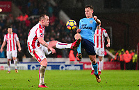 Charlie Adams of Stoke in action with Matt Ritche of Newcastle during the EPL - Premier League match between Stoke City and Newcastle United at the Britannia Stadium, Stoke-on-Trent, England on 1 January 2018. Photo by Bradley Collyer / PRiME Media Images.
