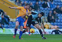 Mansfield Town's Jamie McGuire tussles with Wycombe Wanderers goalscorer Luke O'Nien during the Sky Bet League 2 match between Mansfield Town and Wycombe Wanderers at the One Call Stadium, Mansfield, England on 31 October 2015. Photo by Garry Griffiths.