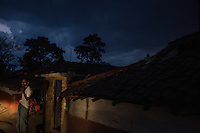 """Sunset in the  Adivasi village of Birbans. Witches are believed to perfom their rituals at night during the fullmoon, gathering in the forest and dancing naked in the nature in order to gather more power and attack villagers on their way back home. Attacks against """"witches"""" are also happening at night, usually neighbors/relatives try to murder the """"witches"""" 2/3 days after the women have been accused to be witches."""