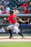 Austin Meadows (19) of the Indianapolis Indians follows through on his swing against the Charlotte Knights at BB&T BallPark on June 19, 2016 in Charlotte, North Carolina.  The Indians defeated the Knights 6-3.  (Brian Westerholt/Four Seam Images)