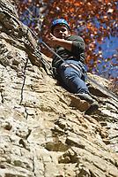 NWA Democrat-Gazette/FLIP PUTTHOFF <br /> George Solis makes his way up the cliff Nov. 16 2018.