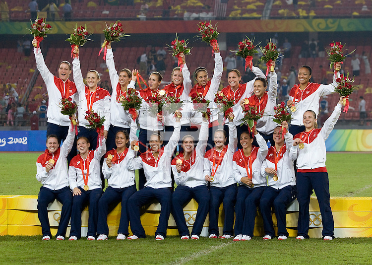 The USWNT poses with the gold medals after playing at Workers' Stadium.  The USWNT defeated Brazil, 1-0, during the 2008 Beijing Olympic final in Beijing, China.