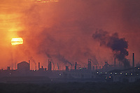 Smoke and dust spew out of Gary Steel Works at sunset, US Steel Corporation, Gary Indiana, 1966. Gary Steel Works stretched across approximately 1500 acres of the shore of Lake Michigan, employed nearly 20,000 workers and operated around the clock, 365 days a year.