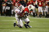 January 5th, 2008:  Rutgers Devin McCourty (21) tackles Ball State's Dante Love (86) during the International Bowl at the Rogers Centre in Toronto, Ontario Canada...Rutgers defeated Ball State 52-30.  ..Photo By:  Mike Janes Photography