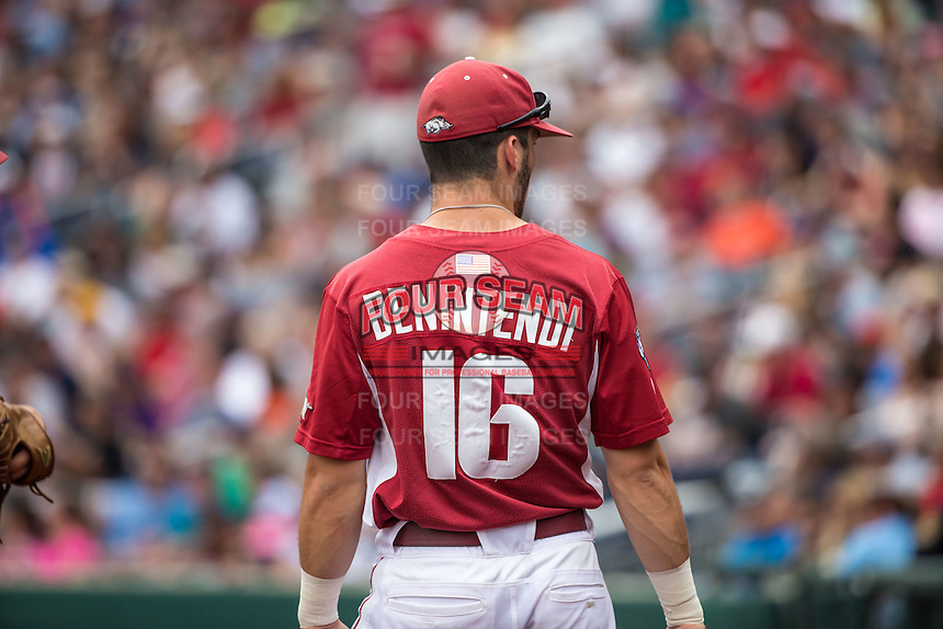 Andrew Benintendi (16) of the Arkansas Razorbacks looks on during a game between the Virginia Cavaliers and Arkansas Razorbacks at TD Ameritrade Park on June 13, 2015 in Omaha, Nebraska. (Brace Hemmelgarn/Four Seam Images)