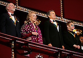 Four of the 2004 Kennedy Center Honorees (L-R) conductor John Williams, opera diva Joan Sutherland, actor Warren Beatty, music legend Elton John take part in the singing of the National Anthem in the presidential box at the Kennedy Center December 5, 2004 in Washington, DC. Six honorees were saluted for their lifetime contributions to American culture through the performing arts. .Credit: Win McNamee - Pool via CNP