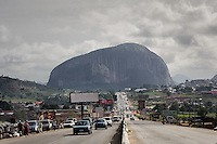 Zuma Rock  is a large monolith (725 metres or 2,379 ft) above its surroundings  along the main road from Abuja to Kaduna, Nigeria.