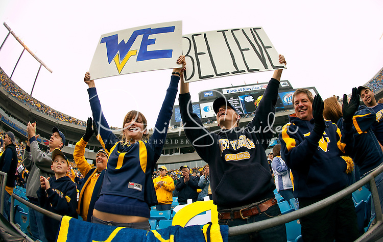 West Virginia fans show their support during the Meineke Car Care Bowl college football game at Bank of America Stadium in Charlotte, NC.