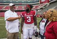 Hawgs Illustrated/BEN GOFF <br /> Kenny Ingram (from left), Arkansas defensive tackles coach, and McTelvin Agim, Arkansas defensive lineman, talk with Ingram's mother Charlene Worsham and wife Carla Ingram Saturday, April 6, 2019, after the Arkansas Red-White game at Reynolds Razorback Stadium.