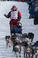 Musher # 11 Michael Suprenant at the Restart of the 2009 Iditarod in Willow Alaska