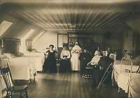 Women's convalescence ward, photograph, early 20th century, in the Musee du Monastere des Augustines, or Augustine Monastery Museum, in Vieux-Quebec or the old town of Quebec City, Quebec, Canada. The monastery was housed in the wings of the Hotel-Dieu de Quebec, a hospital built in 1639. The Historic District of Old Quebec is listed as a UNESCO World Heritage Site. Copyright Fiducie du Patrimoine Culturel des Augustines / Manuel Cohen