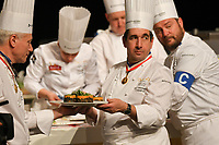 Lyon, 30 January 2019 – The Australian team of Michael Cole (Candidate), Laura Skvor (Commis), Scott Pickett (Coach), and Tom Milligan (President) competing on day two of the 2019 Finale of the Bocuse d'Or held at the Sirha trade show at Eurexpo in Lyon, France. Photo Sydney Low/Bocuse d'Or Australia.