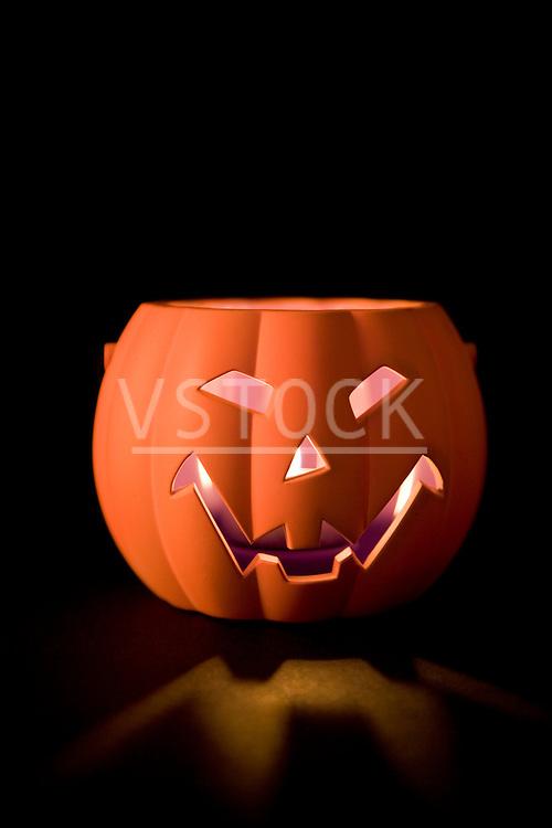 vertical jack-o-lantern decoration still life fall autumn holiday Halloween festive season seasonal tradition traditional custom pumpkin carved frightening scary spooky decor decorative decorated