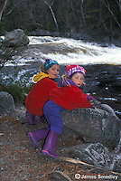 Young girls watching the river rapids