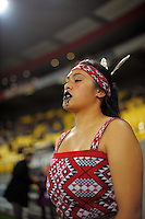 A Mana College student walks out to welcome the teams to the field during the Super Rugby match between the Hurricanes and Sharks at Westpac Stadium, Wellington, New Zealand on Saturday, 9 May 2015. Photo: Dave Lintott / lintottphoto.co.nz