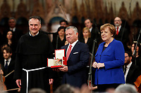 King Abd Allah II of Jordan, Mauro Gambetti and Angela Merkel<br /> Assisi March 29th 2019. St Francis Basilic. The lamp of the Peace 2019 is given to the King of Jordan.<br /> photo di Samantha Zucchi/Insidefoto