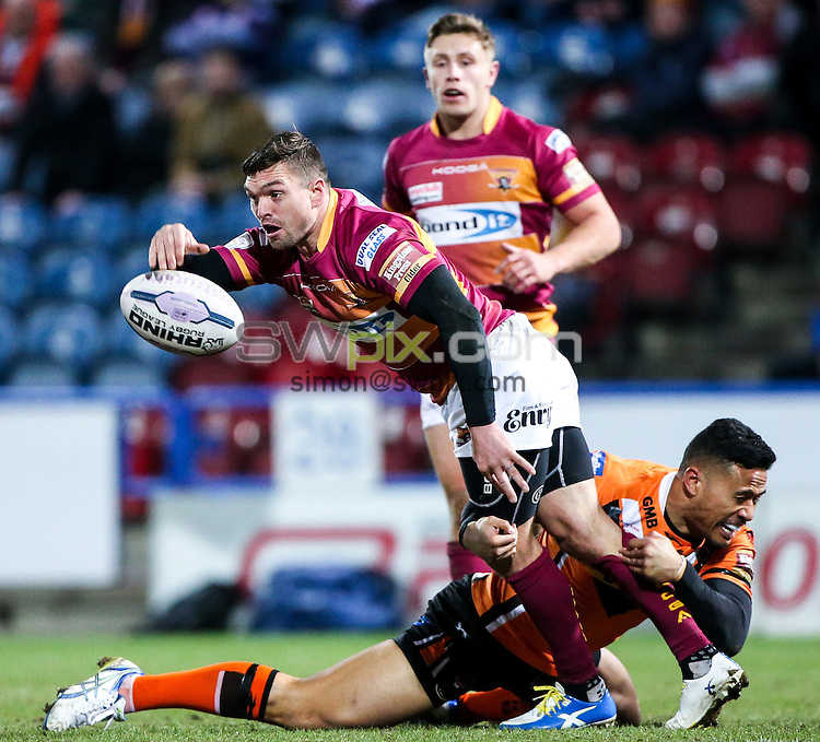 Picture by Alex Whitehead/SWpix.com - 12/03/2015 - Rugby League - First Utility Super League - Huddersfield Giants v Castleford Tigers - John Smith's Stadium, Huddersfield, England - Huddersfield's Danny Brough is tackled by Castleford's Ben Roberts.