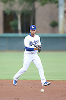 Lucas Tirado (46) of the AZL Dodgers fields a ball between innings of  a game against the AZL Diamondbacks at the Los Angeles Dodgers Spring Training Complex on July 3, 2015 in Glendale, Arizona. Diamondbacks defeated the Dodgers, 5-1. (Larry Goren/Four Seam Images)