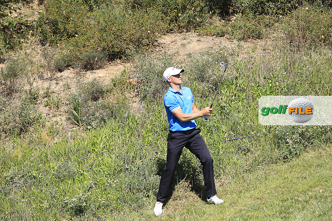 Alex Noren (SWE) on the 15th chips into the hole during Thursday's Round 1 of The Open De Espana at The PGA Catalunya Resort. 15th May 2014.<br /> Picture:  Thos Caffrey / www.golffile.ie