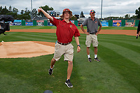 Batavia Muckdogs head groundskeeper Cooper Thomson throws out the ceremonial first pitch after being honored for Field of the Year before a NY-Penn League Semifinal Playoff game against the Lowell Spinners on September 4, 2019 at Dwyer Stadium in Batavia, New York.  Batavia defeated Lowell 4-1.  (Mike Janes/Four Seam Images)