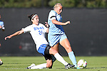 19 October 2014: Duke's Gilda Doria (21) and North Carolina's Emily Bruder (right). The Duke University Blue Devils hosted the University of North Carolina Tar Heels at Koskinen Stadium in Durham, North Carolina in a 2014 NCAA Division I Women's Soccer match. North Carolina won the game 3-0.
