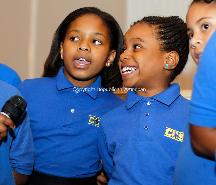 """Waterbury, CT-17 April 2012-041712CM09-  Aniyah Thompson (left) and Anjavie Thompson, students at the Children's Community School sing """"We Are the World"""" during the school's annual dinner at the La Bella Vista Tuesday night in Waterbury.  The girls were with the schools chorus who performed for the attendees at the event.  The school, established in 1969 was started by a group of nuns and parents as a tutoring program for urban kindergarten students.  Today the program offers 12-hour days and a summer program for children in kindergarten through 5th grade.  The school is hoping to expand into middle school grades beginning in the fall of 2013.         Christopher Massa Republican-American"""