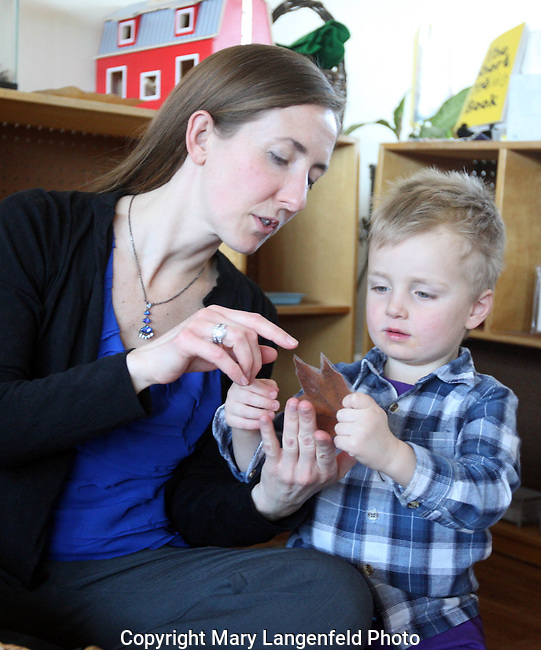 Melissa Droessel shows her student the intricacies of a maple leaf at her Montessori school on Madison's east side.