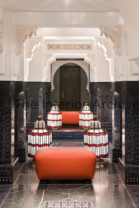 Large glass lanterns in one of the private hammams with intricate wall cornices and tiles