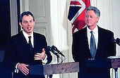 United States President Bill Clinton listens as Prime Minister Tony Blair of Great Britain answers a question during their joint press confrence in the East Room of the White House in Washington, DC on February 6, 1998.  Many of the questions to both leaders were on the Monica Lewinsky Affair.<br /> Credit: Ron Sachs / CNP