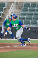 Chase Vallot (15) of the Lexington Legends follows through on his swing against the Kannapolis Intimidators at CMC-Northeast Stadium on May 26, 2015 in Kannapolis, North Carolina.  The Intimidators defeated the Legends 4-1.  (Brian Westerholt/Four Seam Images)