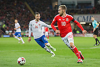 Aaron Ramsey of Wales takes the ball away from Luka Milivojevic of Serbia during the FIFA World Cup Qualifying match between Wales and Serbia at the Cardiff City Stadium, Cardiff, Wales on 12 November 2016. Photo by Mark  Hawkins.