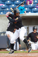 Quad Cities River Bandits outfielder Teoscar Hernandez #4 bats during a game against the Great Lakes Loons at Modern Woodmen Park on April 29, 2013 in Davenport, Iowa. (Brace Hemmelgarn/Four Seam Images)