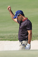 Fabrizio Zanotti (PAR)reacts to holing bunker shot on 1st hole during the final round of the Commercial Bank Qatar Masters, Doha Golf Club, Doha, Qatar. 10/03/2019<br /> Picture: Golffile | Phil Inglis<br /> <br /> <br /> All photo usage must carry mandatory copyright credit (&copy; Golffile | Phil Inglis)