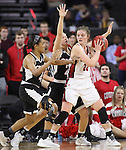 SIOUX FALLS, SD: MARCH 5: Bridget Arens #22 of South Dakota shields the ball from Omaha defenders Jay Bridgeman #40 and Mikaela Shaw #22 during the Summit League Basketball Championship on March 5, 2017 at the Denny Sanford Premier Center in Sioux Falls, SD. (Photo by Dick Carlson/Inertia)