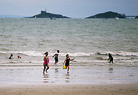 Pictured: Children play in the sea. Saturday 01 July 2017<br /> Re: National Wales Air Show in Swansea Bay, Wales, UK.