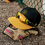 5 March 2019: Pittsburgh Pirates glove, shades, and cap lie near a fence at Pirate City in Bradenton, Florida. Mandatory Credit: Ed Wolfstein Photo *** RAW (NEF) Image File Available ***