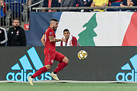 FOXBOROUGH, MA - AUGUST 31: Alejandro Pozuelo #10 of Toronto FC dribbles down the wing during a game between Toronto FC and New England Revolution at Gillette Stadium on August 31, 2019 in Foxborough, Massachusetts.