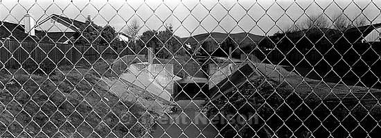 View of San Ramon Creek. through chain-link fence<br />