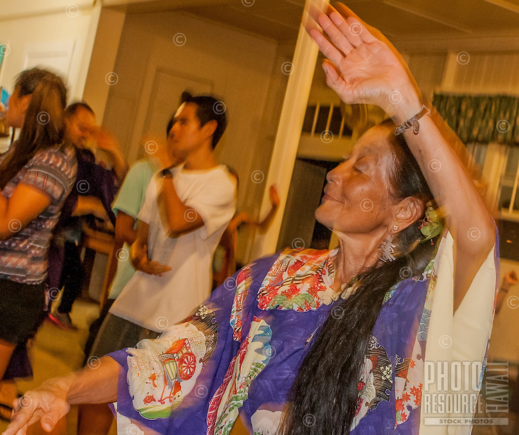An Asian woman in a kimono dances with others at the Hakalau Jodo Mission Bon Dance, Big Island of Hawai'i 2014, where local families come each year to celebrate their ancestors.
