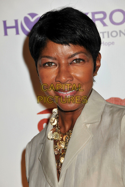 NATALIE COLE <br /> 11th Annual DesignCare Benefit for the HollyRod Foundation held at a Private Residence, Beverly Hills, CA, USA, <br /> 25th July 2009.<br /> portrait headshot beige jacket gold necklace <br /> CAP/ADM/BP<br /> &copy;Byron Purvis/Admedia/Capital Pictures