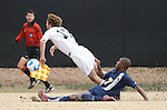 02 December 2007: Wake Forest's Cody Arnoux (17) is fouled by West Virginia's Gift Maworere (ZIM) (7). The Wake Forest University Demon Deacons defeated the West Virginia University Mountaineers 3-1 at W. Dennie Spry Soccer Stadium in Winston-Salem, North Carolina in a Third Round NCAA Division I Mens Soccer Tournament game.