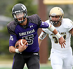 SIOUX FALLS, SD - OCTOBER 18: Luke Papilion #15 from the University of Sioux Falls gains yardage past Blake Pennock #34 from Southwest Minnesota State in the first half of their game Saturday afternoon at Bob Young Field in Sioux Falls. (Photo by Dave Eggen/Inertia)
