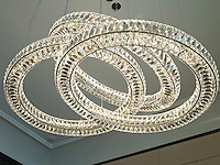 The crystal chandelier in the dining room echoes the styling of Bentley's headlights